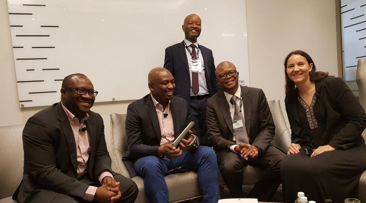left to right, Mr Steven Zwane (NSFAS CEO), Honourable Buti Manamela (Deputy Minister of Higher Education and Training), Joel Baepi (Old Mutual- standing), Old Mutual representative, Dr Genevieve Simpson (CHE)
